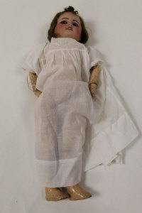 A Nineteenth century bisque headed doll, marked S.F.BJ, length 47 cm.