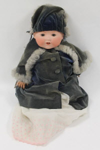 A Armand Marseille bisque headed doll numbered 351/8, length 55 cm.