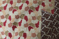 An early twentieth century hand stitched quilt with paisley border.