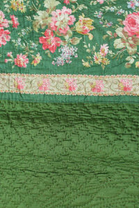 An early twentieth century hand stitched traditional floral quilt.