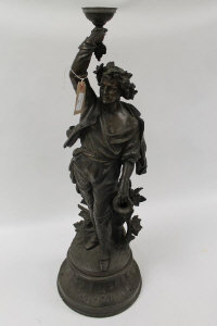 A Victorian bronze figure of a water carrier, on circular wooden plinth, height 77 cm.