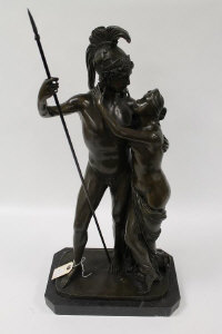A bronze figure depicting  a Roman soldier with maiden, on marble plinth, height 65 cm.