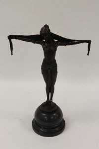 After Demetre H. Chiparus - A bronze figure of an Art Deco style lady  with a head scarf, on marble socle, height 39 cm.