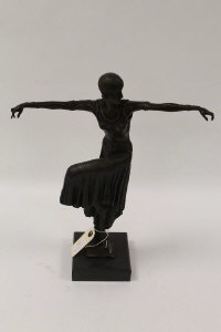 After Demetre H. Chiparus - A bronze figure depicting an Art Deco style dancer with her knee raised, on square marble plinth, height 42 cm.