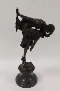 After Demetre H. Chiparus - A bronze Art Deco style lady with a serpent at her feet, on marble socle, height 46 cm.
