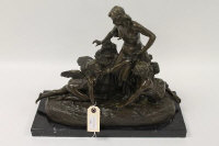 After Joe Descomps  -  A bronze figured group depicting two maidens and a cherub, on black marble plinth, height 35 cm.