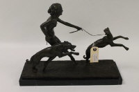 An Art Deco style bronze figure depicting a naked lady with two greyhounds, on black marble plinth, width 41.5 cm.