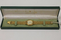 A Gucci Gentleman's wrist watch, boxed.