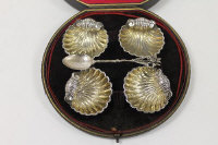 A set of four silver shell salts, Birmingham 1876, boxed