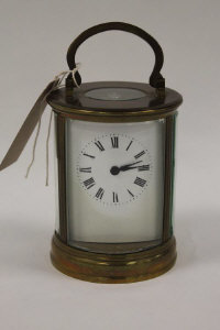A brass French cylindrical carriage clock.
