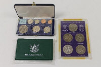 The Royal Silver Wedding Crown collection, together with two New Zealand proof coin sets. (3).