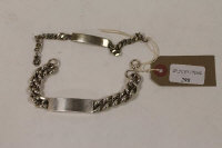 A silver Gentleman's identity bracelet, London 1977, together with another similar. (2)