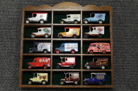 Six wooden display cases containing die- cast vehicles.(Q).