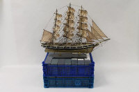 A three-masted model ship on stand, together with thirteen boxed De Agostini ships. (14).