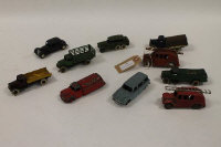 A Dinky Fire truck with bell, together with nine other Dinky vehicles such as Wagon (25a) + Market Gardener's Lorry. (10).