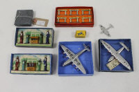 A Dinky King's aeroplane No.62K, together with two Petrol pump 49 sets, an Empire Flying Boat, a Clipper 111 Flying Boat, Meteor aircraft, a Hornby Notice Board No.8 set and a Dinky Midget Kart 512 - with pilot. All boxed.