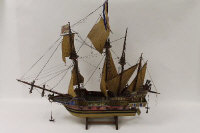 A wooden model galleon, height 73 cm.
