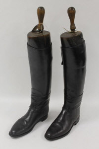 A pair of early twentieth century black leather Lady's riding boots with wooden trees. (2)