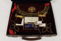 A silver Order of the Buffalo's medal, together with velvet apron in brown leather case. (2).