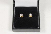 A pair of 18ct gold diamond stud earrings, approximately .6 ct.(2).
