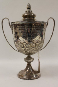 A silver lidded trophy, Sheffield 1936, 55 oz, with wooden base.
