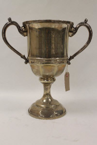 A silver trophy, London 1927, 39 oz, with wooden base.
