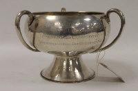 A silver tri-handled trophy, Chester 1911, 25 oz, on wooden base.
