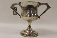A silver trophy, Birmingham 1925, 37 oz, on tiered wooden base.