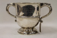 A silver trophy, Birmingham 1923, 40 oz, on tiered wooden plinth with silver mounts.