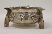 A silver presentation bowl, Chester 1912, 17 oz, on shaped wooden plinth.