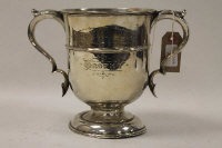 A silver trophy, Sheffield 1901, 33 oz, on tiered silver mounted wooden plinth.