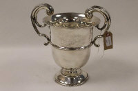A silver trophy, Sheffield 1905, 35 oz, on wooden tiered base.