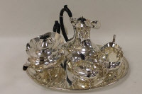 A four piece silver-plated tea service, standing upon an oval tray. (5)