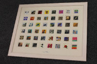 A Royal Mail Millennium stamp collection, framed.