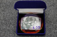 A limited edition Royal Mail 'Britannia £10' paperweight, together with five other stamp paperweights. (6)