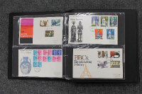 Two albums containing a quantity of First Day Covers. (2)