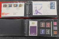 Two albums containing British Post Office Mint stamps and First Day Covers. (2)