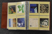 A Royal Mail postcard album, together with an album of First Day Covers. (2)