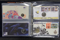 Four albums containing Royal Mint First Day Coin Covers. (4)
