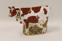 A Royal Crown Derby paperweight - Daisy Cow, height 15 cm.