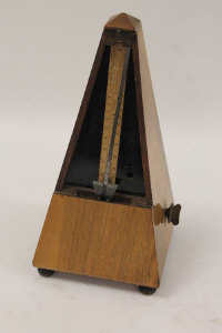 A walnut cased French metronome.
