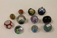 Eleven glass paperweights by Caithness and others. (11)