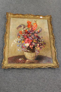 Twentieth Century Continental School  : Still life with mixed flowers in a stoneware vase, oil on board, indistinctly signed, 75 cm x 63 cm, framed.