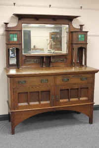 An oak arts and crafts mirror backed sideboard in the style of Liberty & Co, width 153 cm.