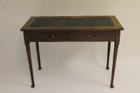 An early nineteenth century two drawer side table, width 107 cm.