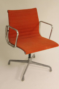 Charles & Ray Eames for Herman Miller : A set of eight aluminium and red fabric covered office chairs. (8)
