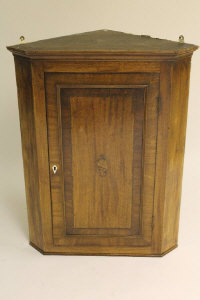 An early nineteenth century inlaid mahogany corner cabinet, width 78 cm.