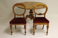 A Victorian mahogany breakfast table width 118 cm, together with six Victorian chairs. (7)