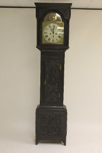 A nineteenth century carved oak longcased clock.