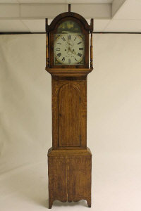 A nineteenth century inlaid oak longcased clock by Dobson, Chester le Street.